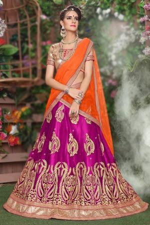 Enchanting Rani Pink Net Heavy Embroidery and Hand Work Lehenga Choli