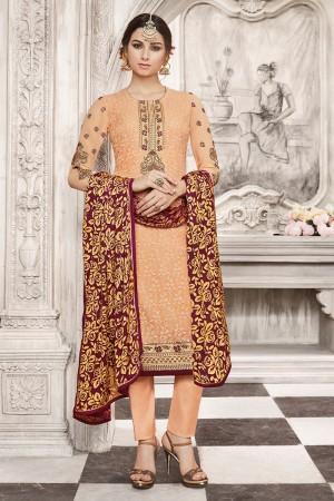 Mesmerising Light Orange Georgette Heavy Embroidery on Neck with Schiffly Work Top Salwar Kameez