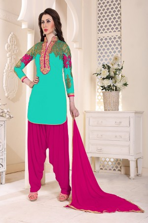 Beauteous Firozi Geordette Heavy Embroidery on neckline and sleeve  Dress material