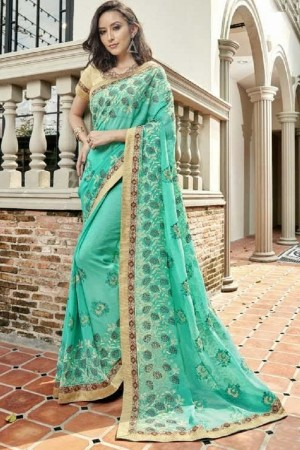 Delightful Rama Faux georgette Embroidery and Lace Border Saree