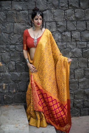Captivating Mustard Weaving Patola Silk Saree