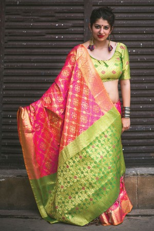 Engrossing Salmon Pink Weaving Patola Silk Saree