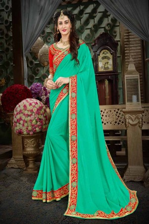 Elegant Turquoise Georgette Zari Embroidered Lace Border with Embroidered Blouse  Saree