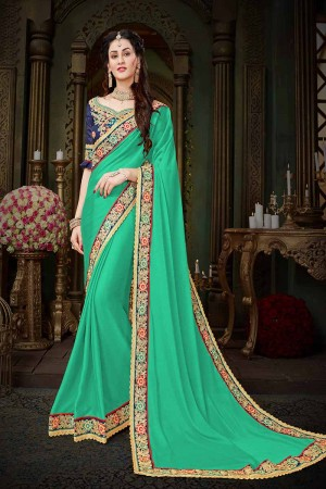 Immaculate Turquoise Georgette Zari Embroidered Lace Border with Embroidered Blouse  Saree