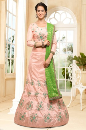 Princely Peach Silk Heavy Embroidery Coding and Stone Work Lehenga Choli