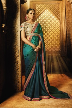 Glossy Peocock Blue Silk Heavy Embroidery Zari and Sequance Work with Multi Color Thread Work Saree