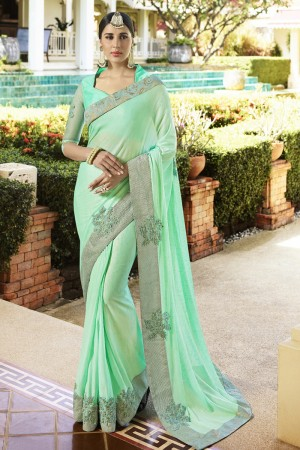 Peppy Light Green Fancy Fabric Plain Saree with embroidery Lace Border Saree
