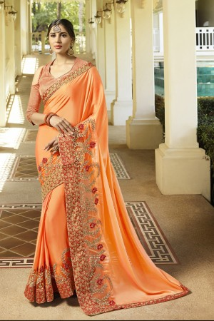 Graceful Orange Fancy Fabric Plain Saree with embroidery Lace Border Saree