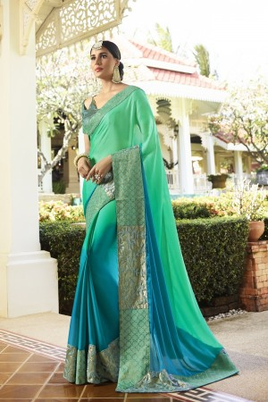 Bewitching RamaGreen Fancy Fabric Plain Saree with embroidery Lace Border Saree