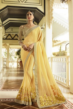 Beautiful Yellow Fancy Fabric Plain Saree with embroidery Lace Border Saree