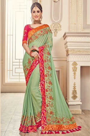 Glossy Green Jaquard Embroidered Saree with Blouse piece