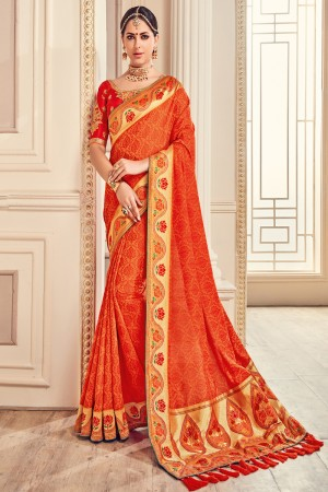 Beauteous Orange Jaquard Embroidered Saree with Blouse piece