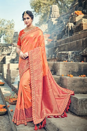 Enthralling Orange Jaquard Silk Embroidered Saree with Blouse piece