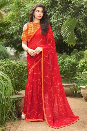 Beguiling Orange Georgette Print with Lace Border Saree