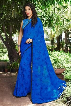 Enriching Dark_blue Georgette Print with Lace Border Saree