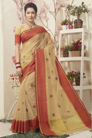 Dazzling Cream Cotton Silk Embroidery Saree