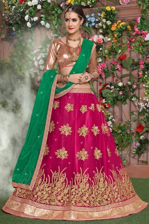 Creative Rani Pink Net Heavy Embroidery and Hand Work Lehenga Choli