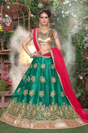 Striking Bottle Green Net Heavy Embroidery and Hand Work Lehenga Choli