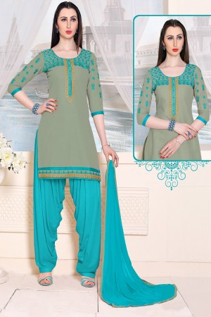 Blooming Mint Green Cotton Heavy Embroidery on Neckline and Sleeve with Lace Border  Dress material
