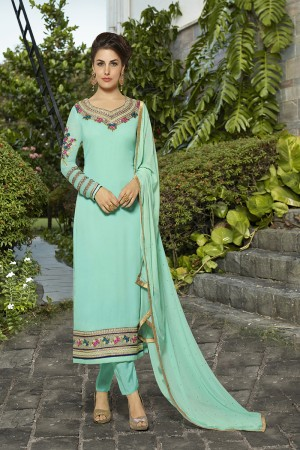 Affluent Turquoice Blue Georgette Heavy Embroidery on Neck and Sleeve with Lace Border Semi Stitch Stright Suit