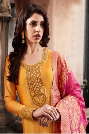 Pleasant Orange Slub Silk Heavy Embroidery On Neck and Sleeve Salwar Kameez
