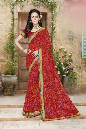 Sensuous Red Georgette Designer bandhani pattern and lace border Saree
