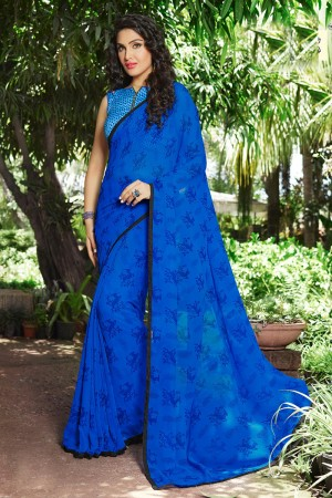Enriching Dark_blue Georgette Print with Lace Border Saree